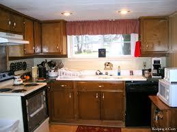 cherry wood red amesbury door reclaimed kitchen cabinets