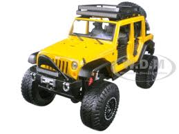 yellow jeep wrangler unlimited jeep wrangler unlimited yellow off road kings 1 24 diecast model car