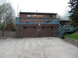 deck over garage dilemma wanting to give this house a face lift