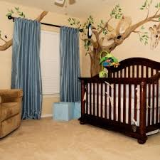 mesmerizing dark wooden baby crib also trees wall decals also blue