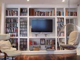 large wall bookshelf design for bedroom with lounge chair