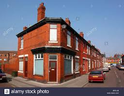 old terraced house and shop buildings with paddington arms on