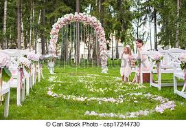 flower arch wedding benches with guests and flower arch for ceremony stock