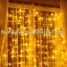 gold curtain lights decorate the house with beautiful curtains