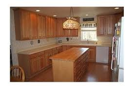 what color appliances look best with cabinets my kitchen has white appliances and light oak cabinets how