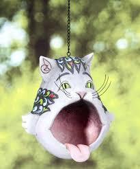 keeping squirrels from bird feeder cat cat blue glass hummingbird