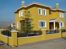 classic and fabulous exterior home color painted in mustard yellow