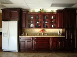 large brown polished wooden cherry kitchen cabinet with cream