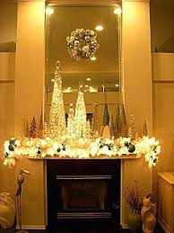 mantle decorated with pine garland and table top trees