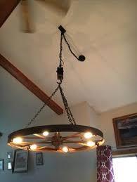 wagon wheel light fixture ww022 wagon wheel chandeliers with downlights light fixtures