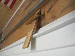 overhead garage door weather stripping sealing around a garage door