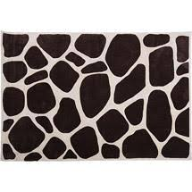 giraffe patterned brown and white rectangular rug
