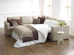 Pillows For Brown Sofa by Brown Sofa With Bench On White Soft Carpet On Wooden Laminate