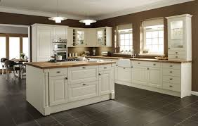 mexican tile with granite white kitchen cabinets black and cream