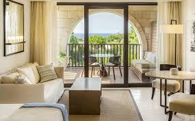 sea view living room deluxe sea view rooms the romanos resort costa navarino