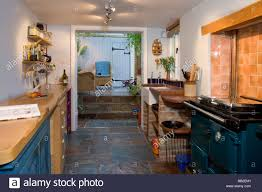 kitchen with a blue aga range cooker stock photo royalty free