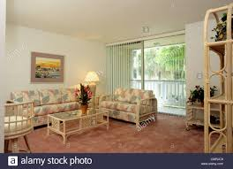 wall carpet 1990s living room pastel furniture pink wall to wall carpet stock