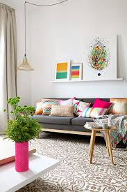colorful sofa pillows brown spanish tiling inside a bright u0026 colorful barcelona apartment