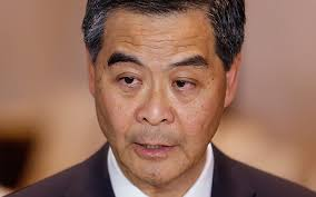 Democracy will lead to      poor      dominating politics  say Hong Kong     s     Hong Kong Chief Executive Leung Chun ying speaks to the media after a presentation ceremony