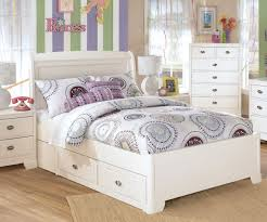 white wooden platform bed with headboard and storage drawers added