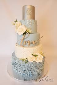 4 tier wedding cake ivory white and dark baby blue with hints if