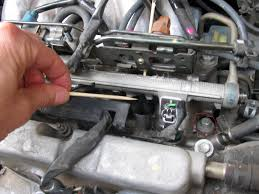 lexus rx300 you tell me where the rear 3 spark plugs