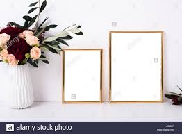 two golden frames mock up on white wall background home decor