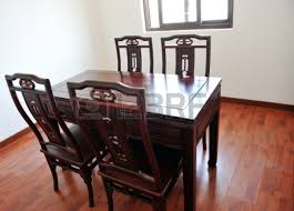 Oriental Dining Table by Chinese Dining Room With Dark Wood Table Four Chairs And Window