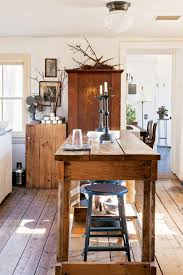 Old Farmhouse Kitchen by Semi Flush Mount Lighting Over Wooden Farmhouse Table With Candle