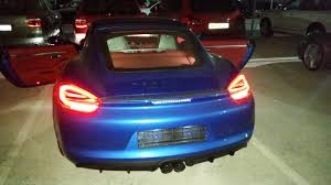 pink porsche interior 2015 sapphire blue cayman gts with red interior