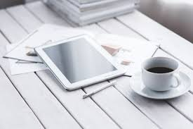 white tablet and cup of coffee free stock photo