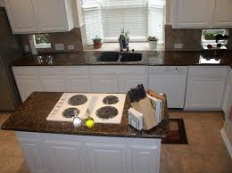 brown granite countertops with white cabinets baltic brown granite white cabinets backsplash ideas