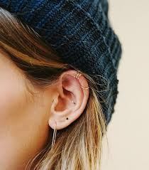 creative earrings how to wear earrings at once whowhatwear