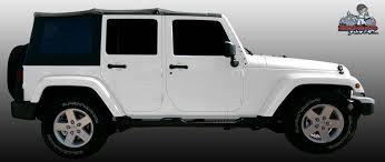 white four door jeep wrangler the bad wrap