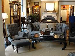 luxury man cave with grey tufted wing chairs and table also