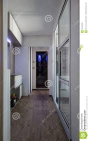small apartment hallway narrow entrance with led lights and big