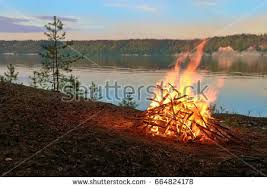 Sparks Fireplace - big night bonfire on riverbank forest stock photo 504858019
