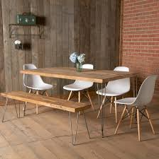 interior long brownen table with black steel legs plus bench on