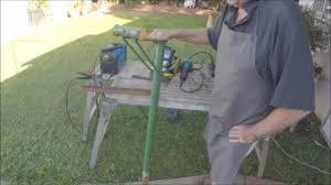 old bike stand becomes new backyard hose stand youtube