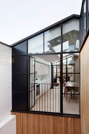 courtyard home de rosee sa uses cobbled courtyards to bring light into house