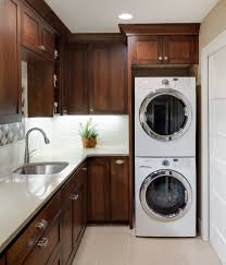 stacked washer dryer laundry room traditional with built in
