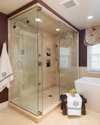 large white fiberglass tubs mixed black ceramic floor as well f an inviting walk in shower features beige marble tiles that