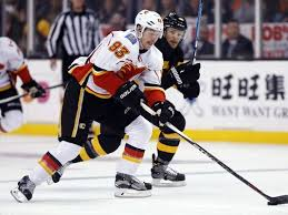 chad johnson makes 35 saves flames beat bruins 2 1