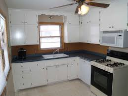 Refinish Kitchen Cabinets Before And After Painting Kitchen Cabinets Black Before And After Interesting