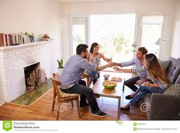 couple entertaining friends at home stock image image 85209341