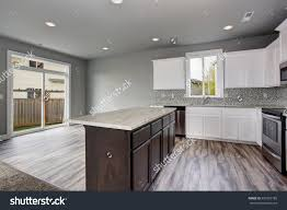 unique kitchen gray hardwood floor well stock photo and white