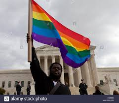 Usa Rainbow Flag African American Man Waving Rainbow Flag In Front Of The Us