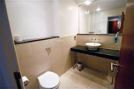 Hotel Bathroom Ideas Bathroom Unique White Bowl Sink On Black Granite Top Floating