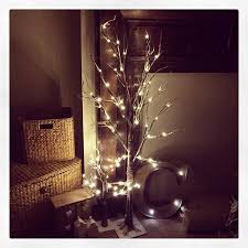 small led light up indoor outdoor snow covered brown twig tree