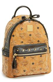 mcm designer got to the gold studs on this mcm logo print backpack